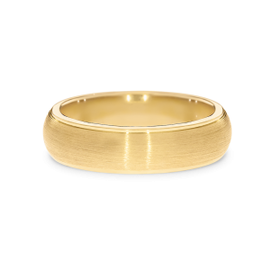 Yellow gold wedding band in a brushed finish and polished edges
